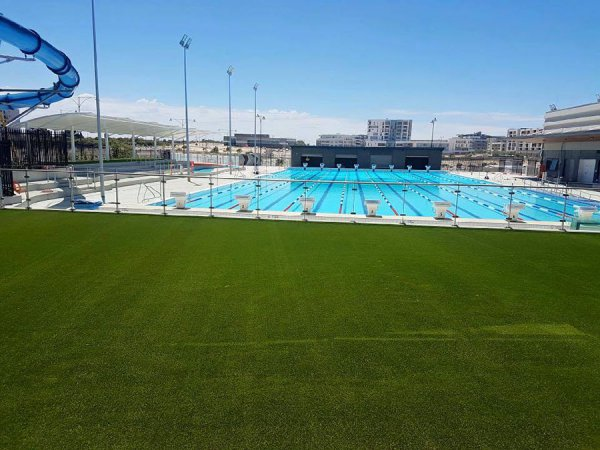 fake grass around an Olympic swimming pool