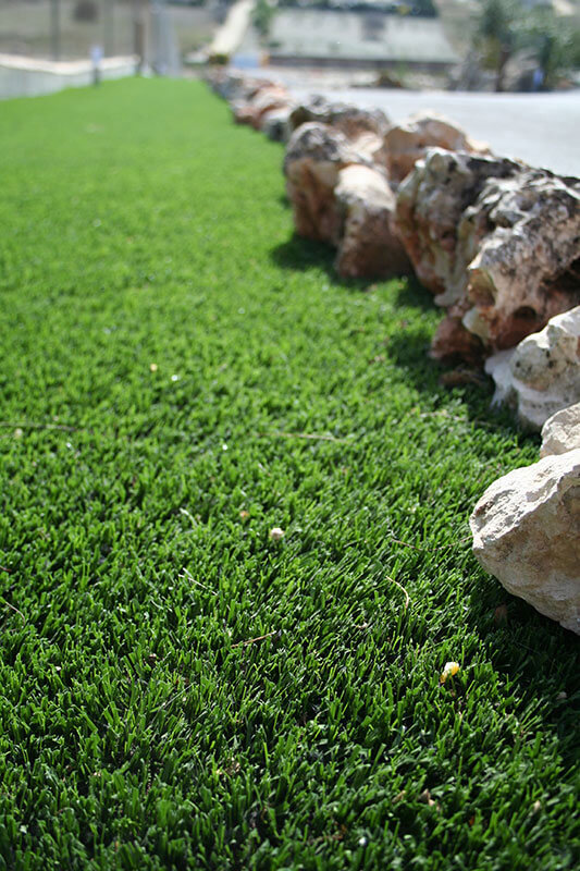 artificial grass on a public road side